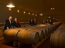Family with oak barrels in the cellar